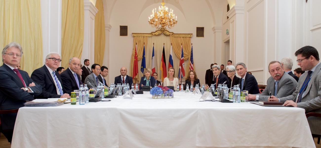 Wendy Sherman, fourth from right, sits next to then U.S. Secretary of State John Kerry during the P5+1 group session at the Iranian Nuclear Negotiations in Austria, July 9, 2015.
