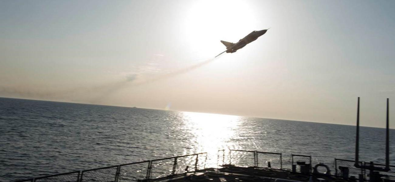 A Russian Sukhoi Su-24 attack aircraft makes a low altitude pass by USS Donald Cook