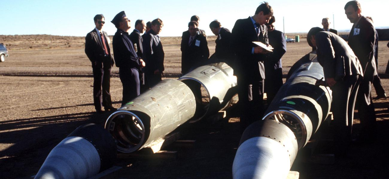 Soviet inspectors and their American escorts standing among dismantled Pershing II missiles in Colorado as other missile components are destroyed nearby under the INF Treaty, January 1989.