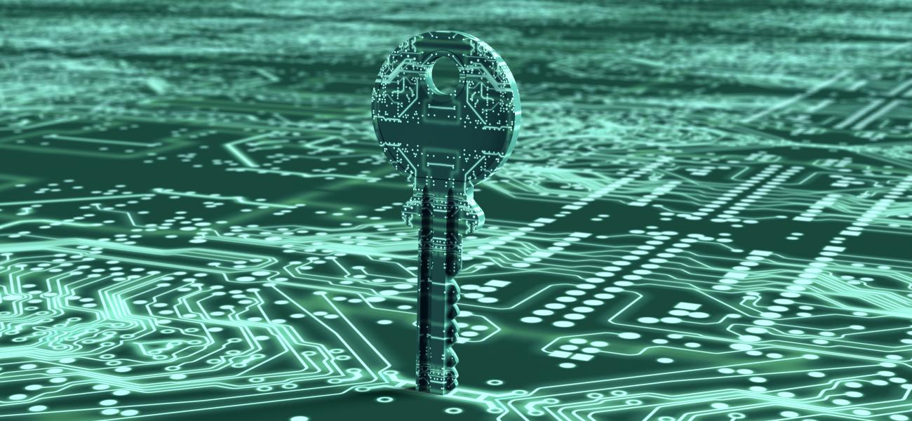 A key made out of circuits unlocking a circuit board.