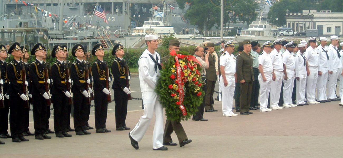 Russian and U.S. sailors honoring military personnel who perished during World War II, Vladivostok, Russia, July 4, 2002