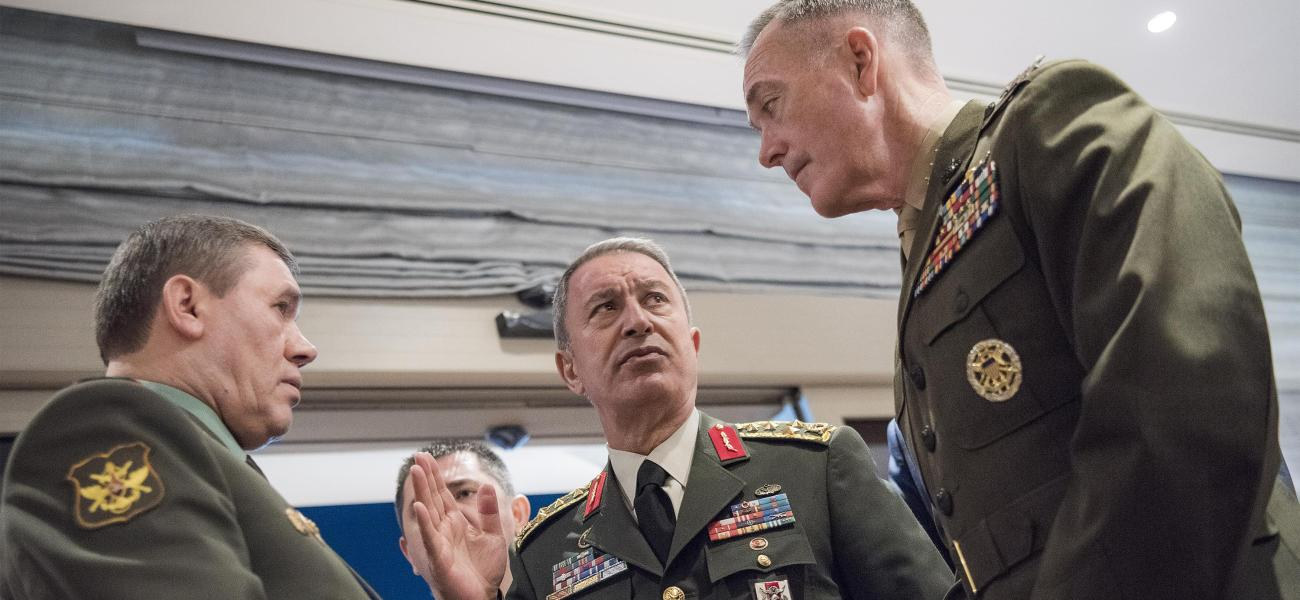 U.S. Gen. Joe Dunford, Russian Gen. Valery Gerasimov and Turkish Gen. Hulusi Akar discussing the Syrian conflict in March 2017.