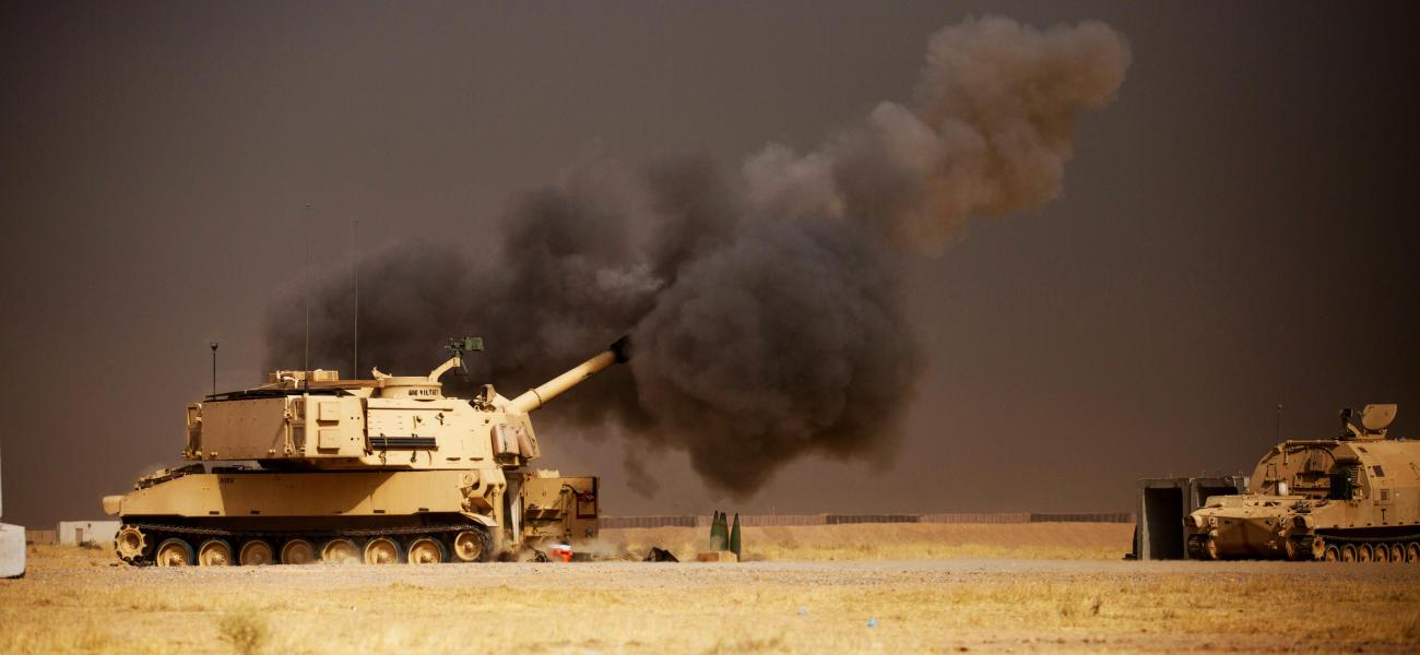 A U.S. Army M109A6 Paladin conducts a fire mission in Iraq.