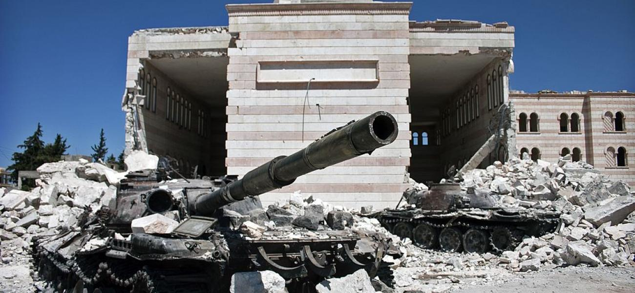 Two destroyed tanks in front of a mosque in Azaz, Syria.