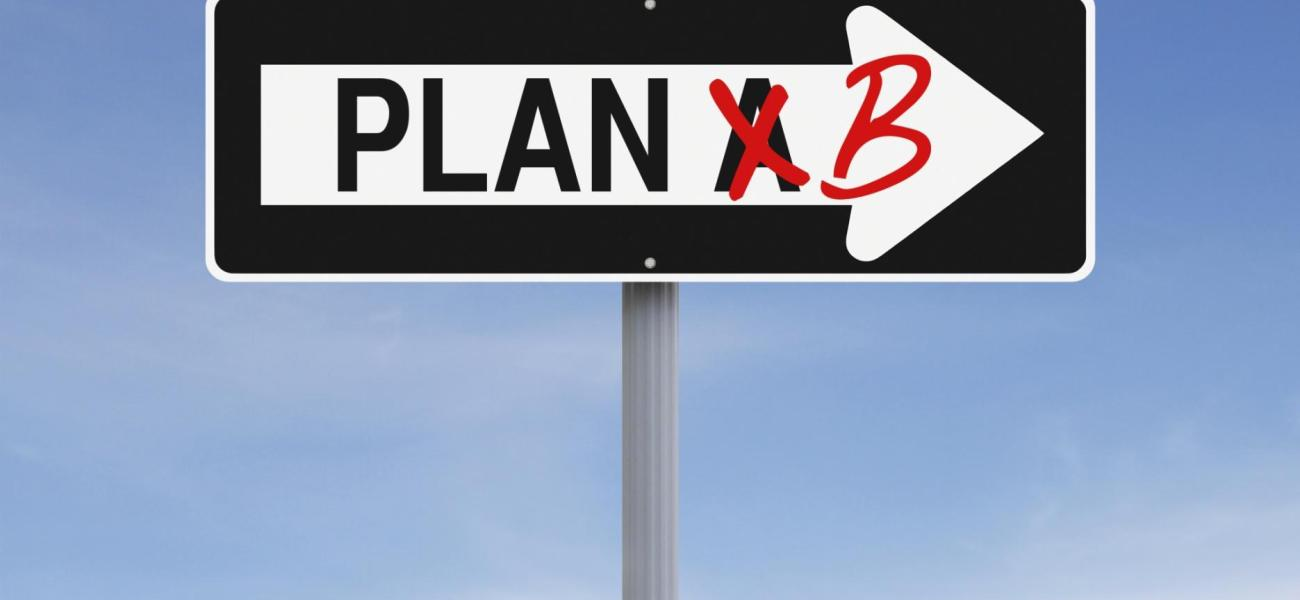 "A one-way arrow saying ""Plan A"" with the ""A"" crossed out and a ""B"" written in in red instead."