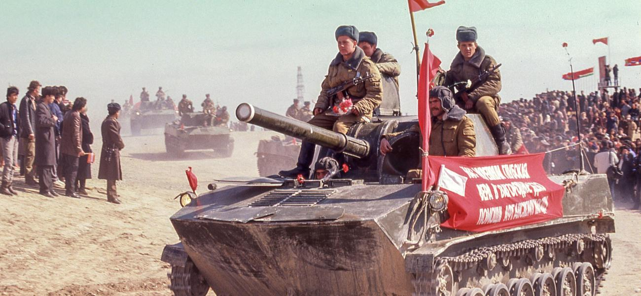 A light tank with Soviet troops, the last Soviet soldiers to leave Afghanistan, ride to a ceremony in the Uzbek Soviet Socialist Republic.   (Arnold Drapkin/ZUMAPRESS.com)