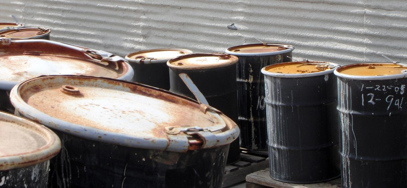 Oil drums heaped together.
