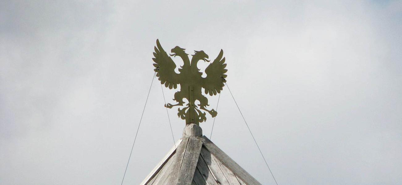 Russian double-headed eagle against the sky.