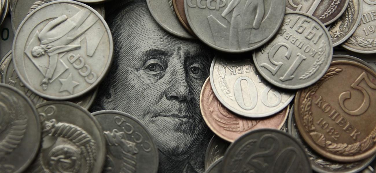 Benjamin Franklin peeking out from among Russian rubles