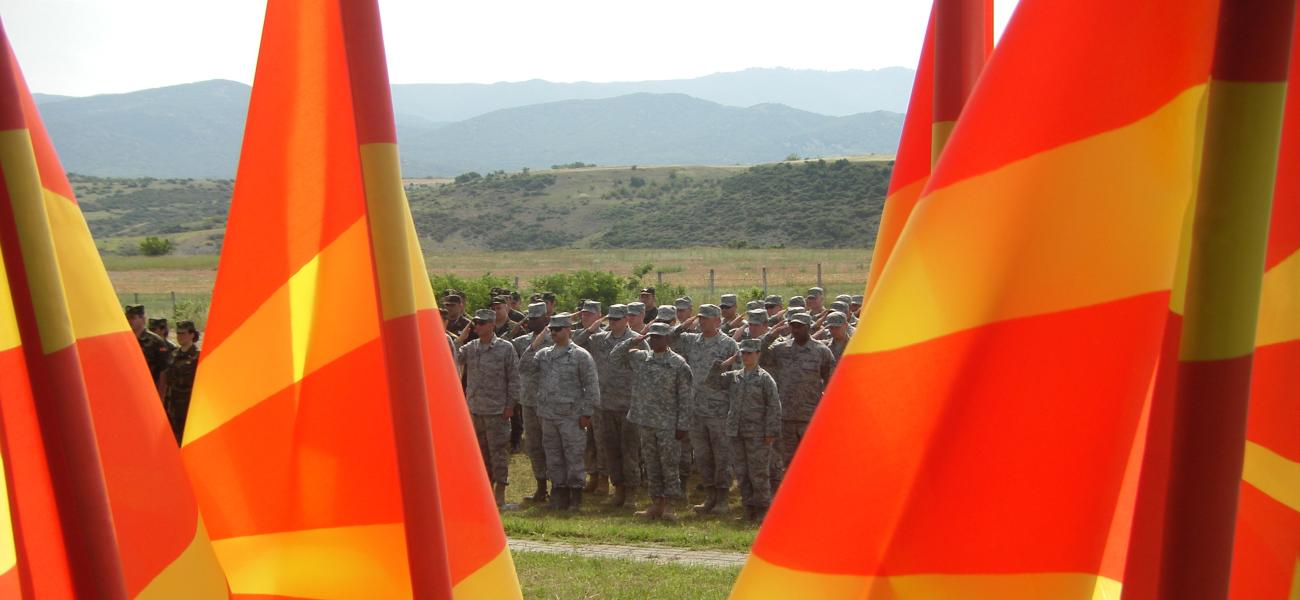 U.S. military personnel seen through Macedonian flags