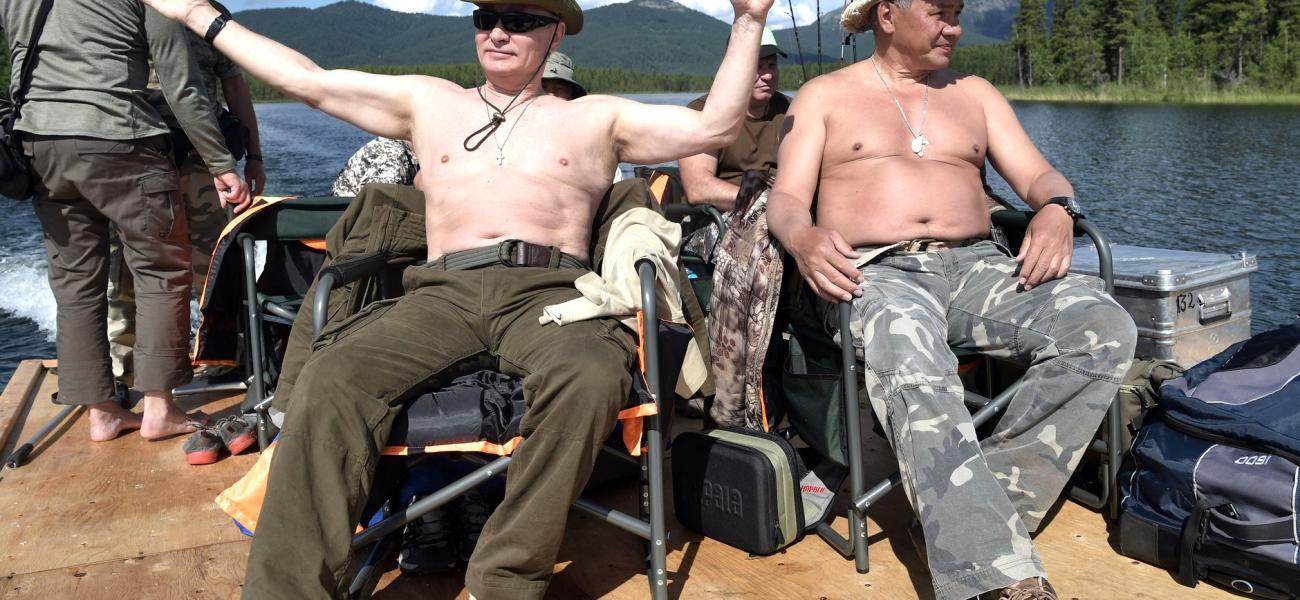 Russian President Vladimir Putin with Defense Minister Sergei Shoigu relaxing shirtless on a boat in Siberia.